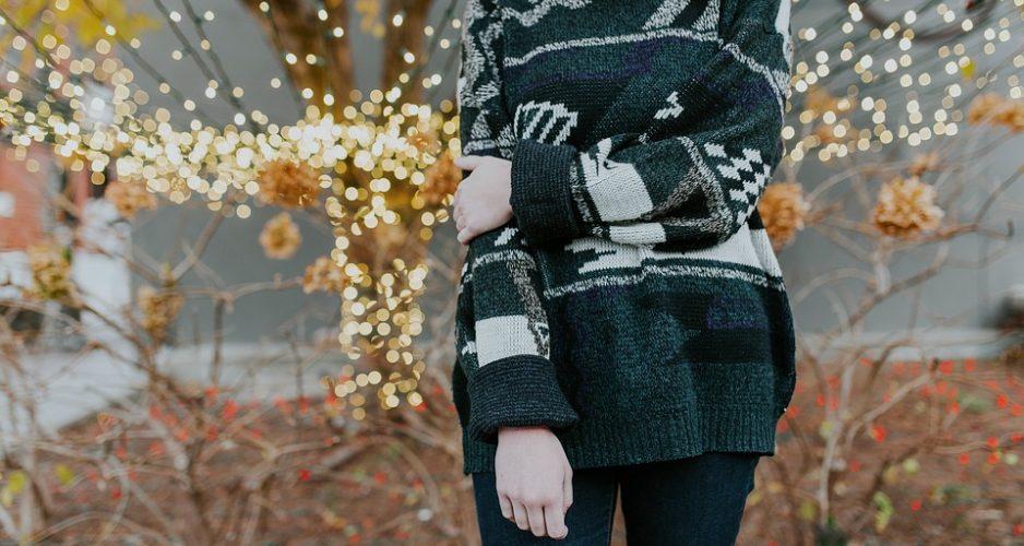 woman wearing Christmas sweater